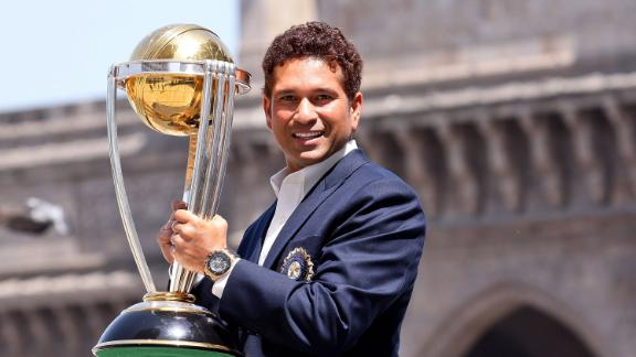 Sachin Tendulkar poses with the  ICC Cricket World Cup Trophy in 2011.