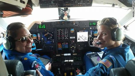 Waddington and Twining in the cockpit of the Gulfstream IV jet they flew toward Hurricane Hector.