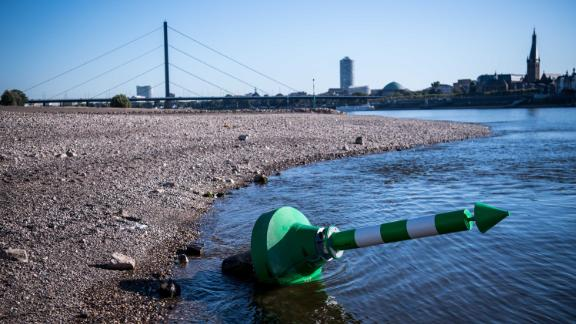 A buoy lies on the dry Rhine riverbed on a searing hot day in Dusseldorf, Germany, in August.