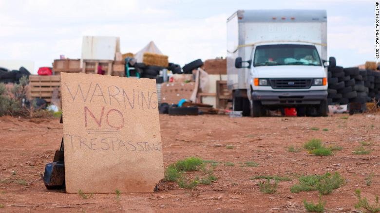 "This Aug. 5, 2018 photo shows a ""no trespassing"" sign outside the location where people camped near Amalia, N.M. Three women believed to be the mothers of 11 children found hungry and living in a filthy makeshift compound in rural northern New Mexico have been arrested, following the weekend arrests of two men, authorities said Monday, Aug. 6. (Jesse Moya/The Taos News via AP)"