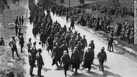 "Prisoners arriving at a ""cage"" near Amiens, following fighting for the town in August 1918."