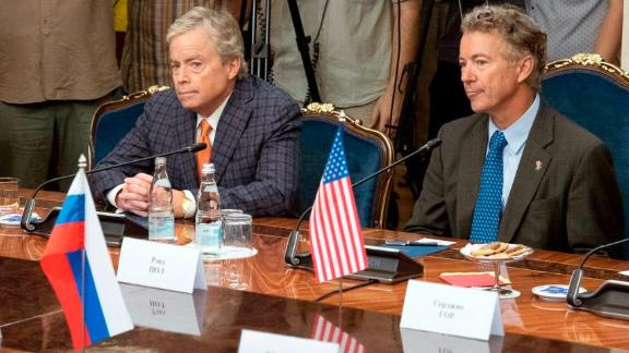 Top from left: a member of the Senate of the legislative Assembly of the state of Texas Peter Hettler, Texas Sen. Don Huffines, Sen. Rand Paul and his communications director Sergio Gor attend a meeting with Russian lawmakers in Moscow, Russia, Monday, Aug. 6, 2018. Paul said he has invited Russian lawmakers to visit the United States to help foster inter-parliamentary contacts. (AP Photo/Pavel Golovkin)