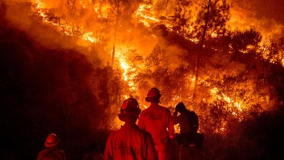 Firefighters monitor a backfire while battling part of the Mendocino Complex Fire near Ladoga on Tuesday, August 7.