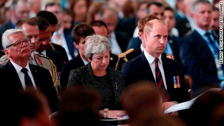 The Duke of Cambridge (R), British Prime Minister Theresa May and former German president Joachim Gauck attend a ceremony to mark the centenary of the Battle of Amiens at the cathedral in Amiens, France.