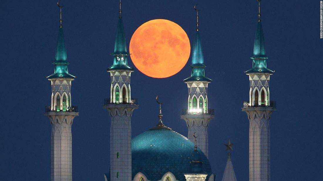 The blood moon is seen over the Qolsarif Mosque in Kazan, Russia, on Friday, July 27.