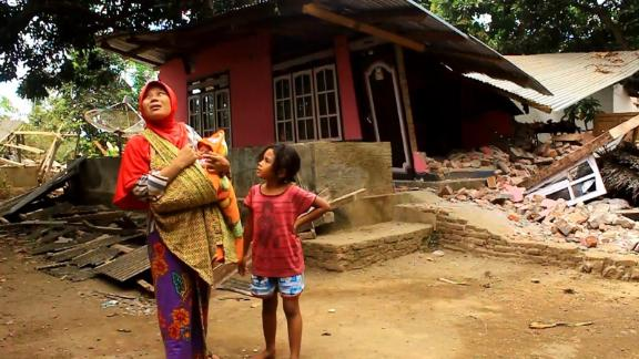Sumiati returned to her home to survey the damage and found the roof partially collapsed.