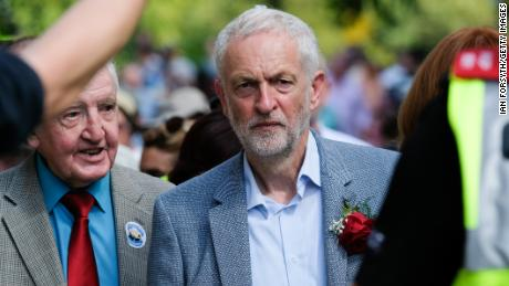 Corbyn walks through crowds after delivering a speech in Durham, England in July.