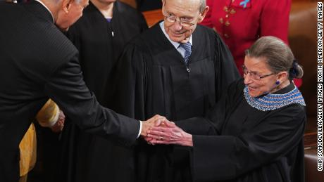 Sen. Orrin Hatch (R-UT) (L) shakes hands with U.S. Supreme Court Associate Justice Ruth Bader Ginsburg (R) as Associate Justice Stephen Breyer look son before President Barack Obama delivers the State of the Union address to a joint session of Congress in the House Chamber at the U.S. Capitol on January 28, 2014 in Washington, DC.