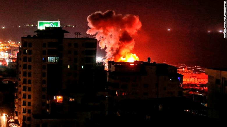 Smoke rises following an Israeli air strike on Gaza City.