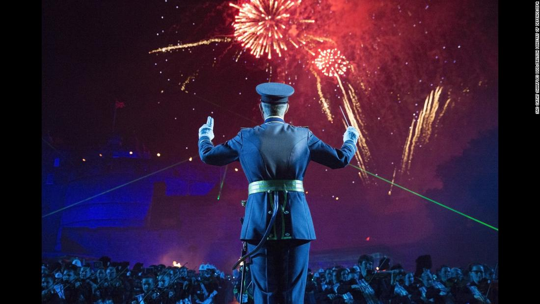 Wing Commander Piers Morrell, principal director of music for the Royal Air Force, conducts performers during a dress rehearsal for the Royal Edinburgh Military Tattoo, which is taking through August 25 in Edinburgh, Scotland.