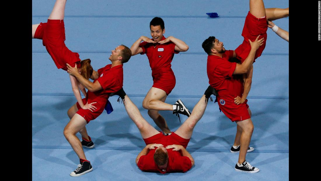 "Cheerleaders perform during the Gay Games in Paris on Monday, August 6. <a href=""https://www.cnn.com/2017/05/02/asia/gay-games-hong-kong/index.html"" target=""_blank"">The Gay Games</a> are held every four years, like the Olympics, and their mission is to promote equality through an international sports and cultural event that is gay-friendly and inclusive, as heterosexual participants are welcomed as well."