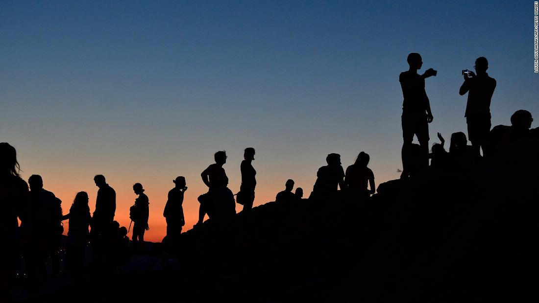 "People watch a sunset atop the Aeropagus hill in Athens, Greece, on Monday, August 6. <a href=""http://www.cnn.com/2018/08/02/world/gallery/week-in-photos-0803/index.html"" target=""_blank"">See last week in 19 photos</a>"