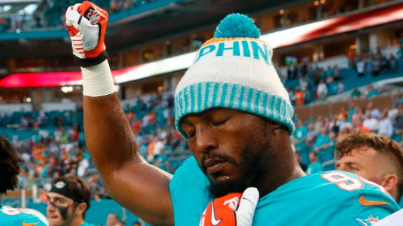 Miami Dolphins defensive end Robert Quinn raises his fist Thursday night.