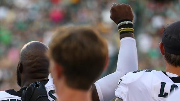 Malcolm Jenkins #27 of the Philadelphia Eagles raises his fist during the national anthem as Chris Long #56 puts his arm around him prior to the preseason game against the Pittsburgh Steelers at Lincoln Financial Field on August 9, 2018 in Philadelphia, Pennsylvania. The Steelers defeated the Eagles 31-14. Mitchell Leff/Getty Images