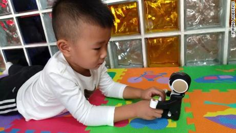 RoBoHon, a robot powered by AI system customized for children, has been used in a Chidlren's Hospital in Harbin for children with autism.