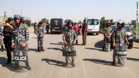 Egyptian police form a perimeter after a suicide bomber detonated an explosive belt after being denied entry to a Coptic Christian church on  August 11.