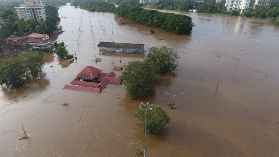 The Shiva Temple in Kochi, Kerala state, is partially submerged on August 9.