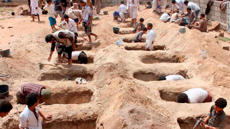 Yemenis dig graves for children killed in the attack.