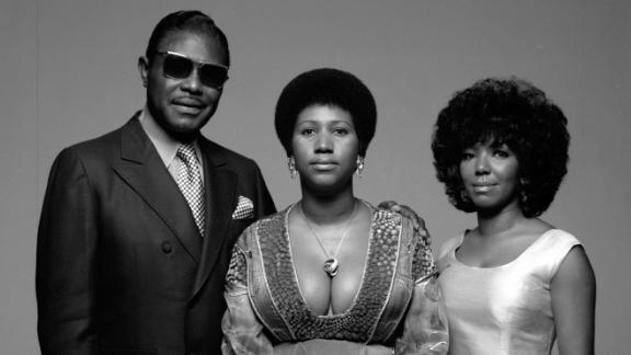 Aretha Franklin sits for a portrait with her father, Baptist preacher