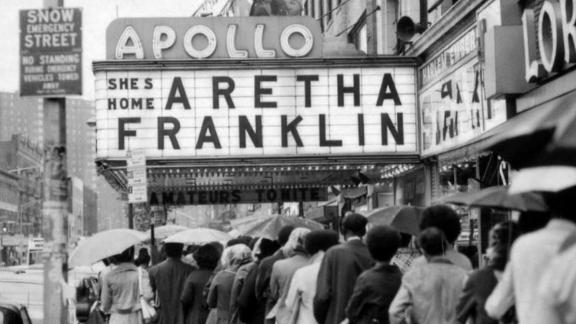 Crowds gather for a performance by Franklin at the Apollo Theater in New York City on June 3, 1971.