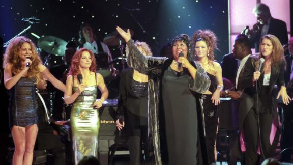 """Franklin performs with, from left, Mariah Carey, Gloria Estefan, Carole King (obscured), Shania Twain and Celine Dion during the """"Divas Live - An Honors Concert for VH1 Save the Music"""" at New York"""