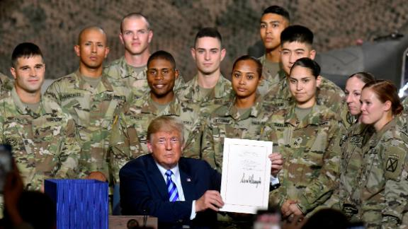 President Donald Trump signs the John McCain National Defense Authorization Act for the Fiscal Year 2019, during a signing ceremony Monday, Aug. 13, 2018, in Fort Drum, N.Y. (AP/Hans Pennink)