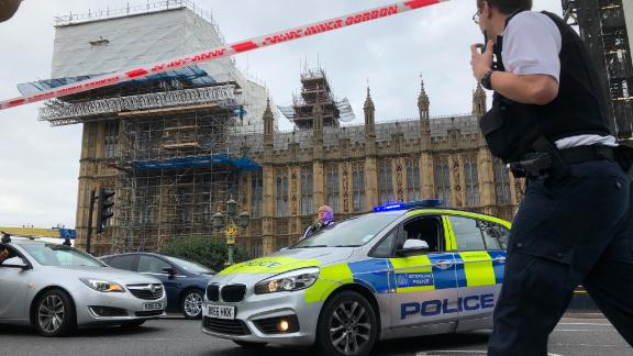 Police cordon off an area around Westminster after a man crashed a car into security barriers outside Parliament in London, England, on Tuesday, August 14.