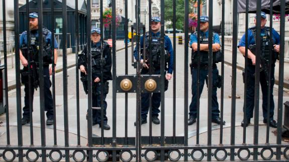 Police stand on alert at No.10 Downing Street in London, on Tuesday, August 14, after a car crashed into a barrier outside of the Houses of Parliament.