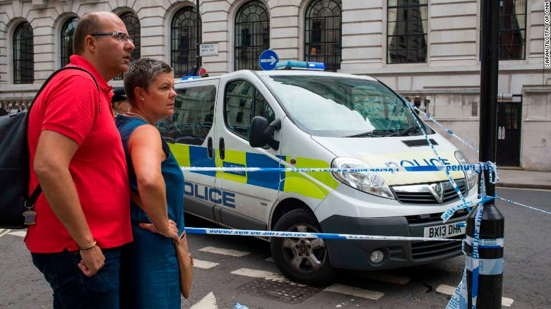 Jean and Carole Gautier, from Amiens, France, stand outside a police cordon. The couple was on their way to visit Westminster Abbey during their first visit to London, when the crash happened.