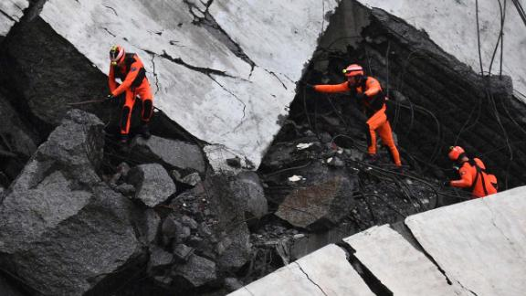 Rescuers work Tuesday amid the rubble.