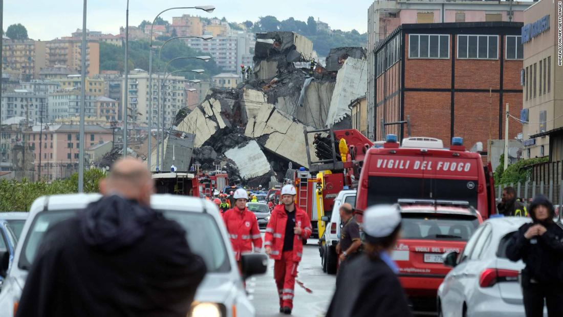 Emergency crews gather at the site of the bridge collapse.
