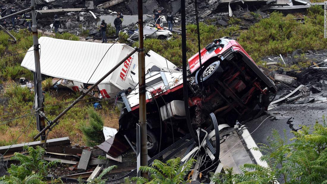 A truck is seen in the wreckage of the bridge.