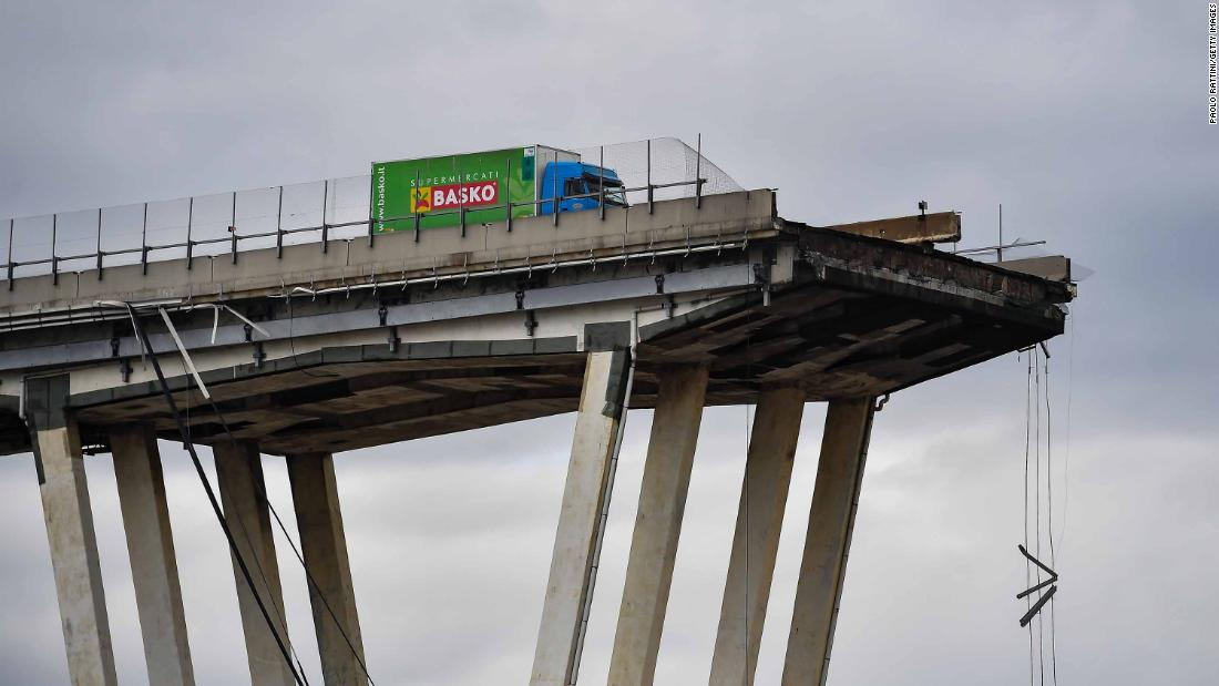 A truck is seen near the edge of a section of the bridge that collapsed.