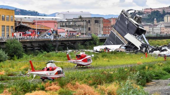 Two rescue helicopters land near the Morandi Bridge.
