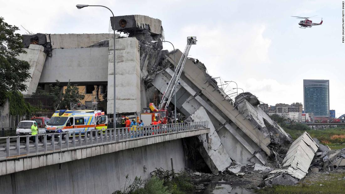 A helicopter flies over the site of the Morandi Bridge collapse in Genoa, Italy, on Tuesday, August 14.