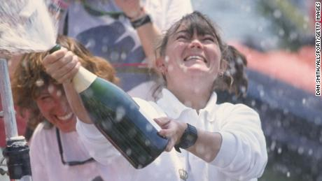 Tracy Edwards, skipper of Maiden, celebrates with champagne after finishing second during the Whitbread round the world yacht race in 1990.