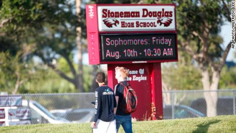 Student walk to class at Marjory Stoneman Douglas High School, Wednesday, Aug. 15, 2018, in Parkland, Fla. Students at the school returned Wednesday, to a more secure campus as they began their first new school year since a gunman killed 17 people in the freshman building. (AP Photo/Wilfredo Lee)