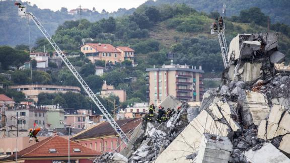 Rescue crews work on Tuesday, August 14, 2018, to recover survivors amid the remains of the collapsed Morandi Bridge in Genoa, Italy.