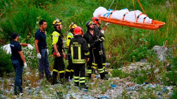 Rescuers on Tuesday recover the body of a victim.