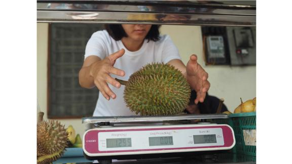 """On the nose: """"The typical stinky egg and onion sulfur smell comes out in later stages of ripeness and, often, the smell wafting up and down streets is really the rotting shells,"""" she adds. """"Really, fresh durian smells mild and gassy like fresh grass."""""""
