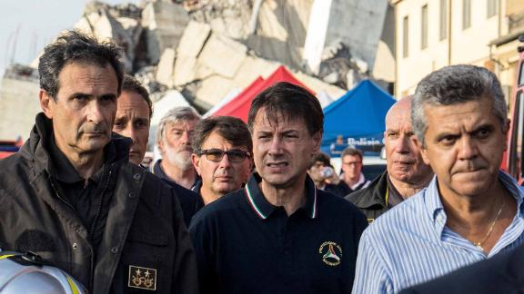 Italian Prime Minister Giuseppe Conte (center) visits the site of the collapse.
