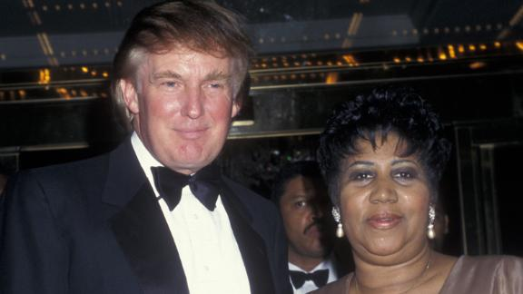 Legendary singer Aretha Franklin and future president, Donald Trump, attend the grand opening of the Trump International Hotel and Tower on May 19, 1997 in New York City.