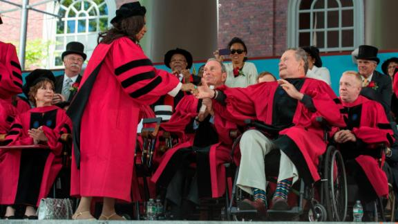 Former President George H.W. Bush congratulates Franklin after she was awarded an honorary doctorate at Harvard University commencement on May 29, 2014.