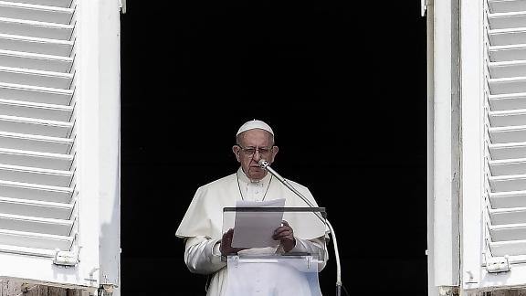 Pope Francis reads to pilgrims during The Angelus Prayer from the window of his studio overlooking St. Peter's Square, The Vatican on August 15, 2018, on The Feast of Assumption. - The pontiff said his thoughts are with the families of the victims, the wounded and the displaced following the deadly Morandi bridge collapse in Genoa. (Photo by FILIPPO MONTEFORTE / AFP)        (Photo credit should read FILIPPO MONTEFORTE/AFP/Getty Images)