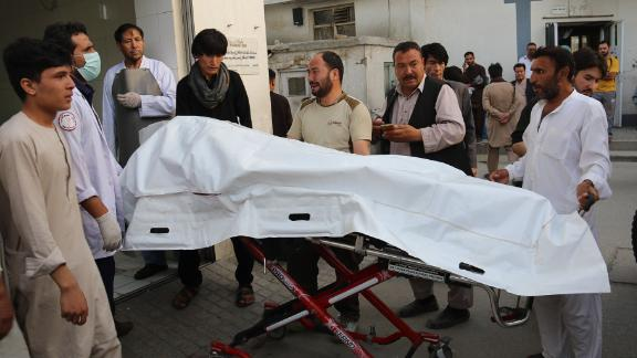 Afghan volunteers carry a body on a stretcher to a hospital Wednesday after a suicide attack in Kabul.