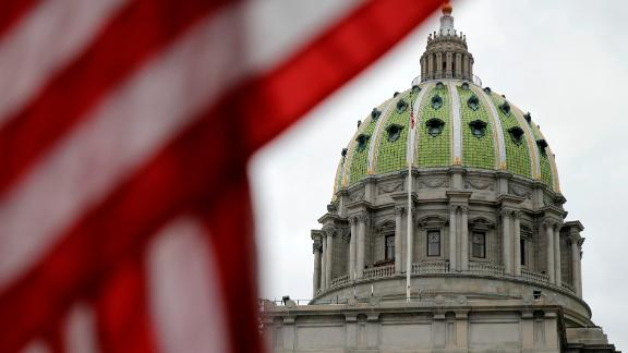 FILE - This Wednesday, Oct. 7, 2015 file photo shows the Pennsylvania Capitol building in Harrisburg, Pa. An Associated Press analysis, using a new statistical method of calculating partisan advantage, finds traditional battlegrounds such as Michigan, North Carolina, Pennsylvania, Wisconsin, Florida and Virginia were among those with significant Republican advantages in their U.S. or state House races in 2016. (AP Photo/Matt Rourke)