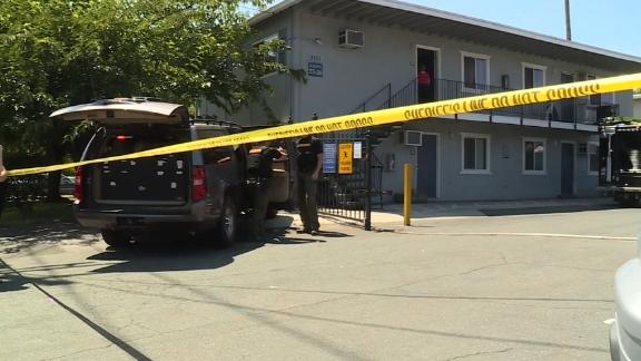 Officials from multiple state and federal law enforcement agencies gather evidence from a Sacramento, California,  apartment complex where Ameen was taken into custody on Wednesday.