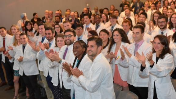 New NYU medical students found out Thursday at their white coat ceremony that their tuition would be covered by a new scholarship.