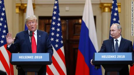Trump speaks beside Russian President Vladimir Putin during a press conference after their meeting at the Presidential Palace in Helsinki, Finland, Monday, July 16, 2018.