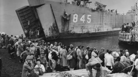 Civilians from Hungnam in North Korea board the landing ship USS Jefferson County as they flee their city during the Korean War on December 19, 1950.